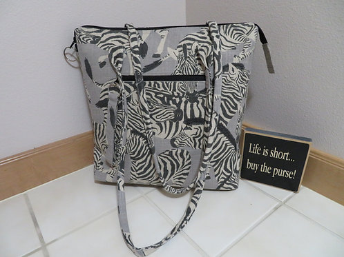 Zebra bag with exterior zippered cell phone pocket