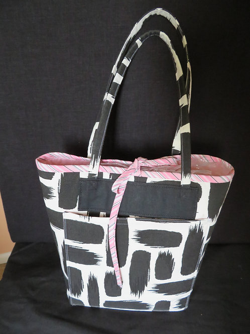 Black brush strokes on cream fabric with pink tie and interior lining