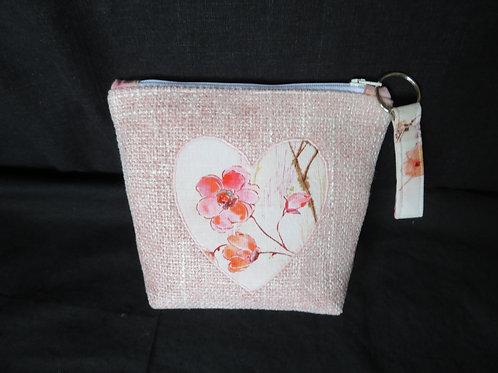 Love in Bloom accessory bag on pink tweed