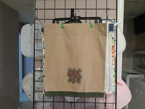 Tea towel with pine cone print