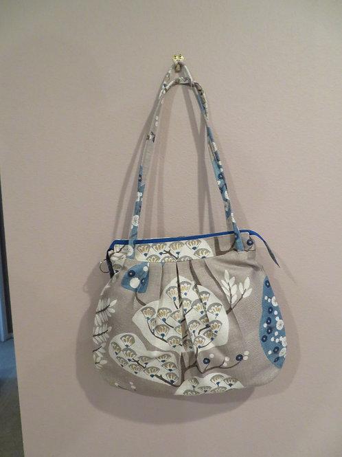 Floppy shoulder bag in blue and tan tree pattern
