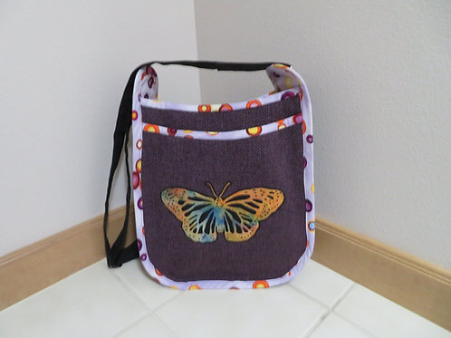 Golden butterfly on purple background
