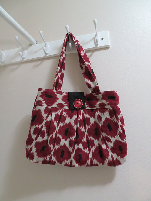 Red stylized floral print with red button top closure