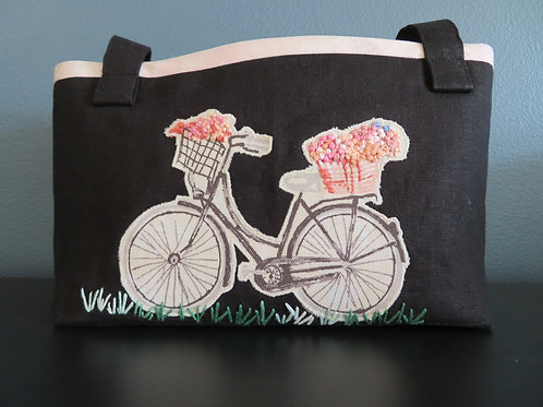 Bicycle Bag for handlebars with embroidered flowers in basket