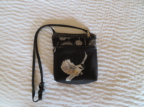 Black crossbody with adjustible leather strap