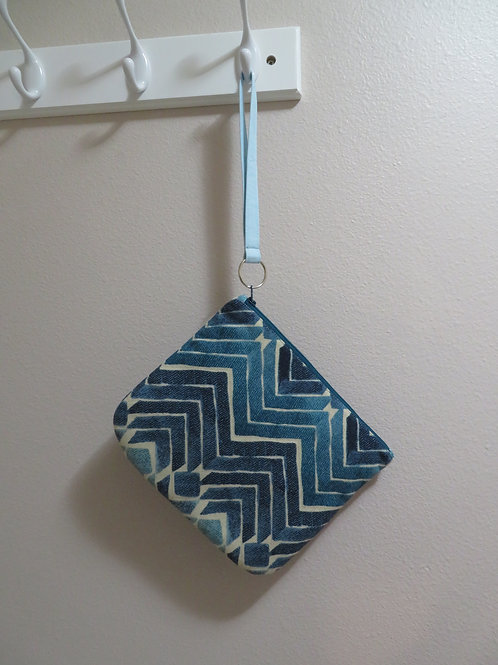 Blue and white zigzag pattern with zippered closure