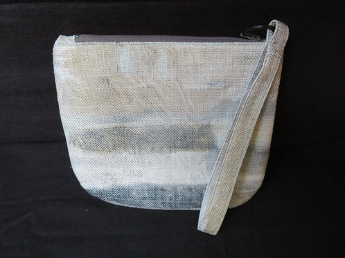 Quilted ombrey of gray and gold clutch