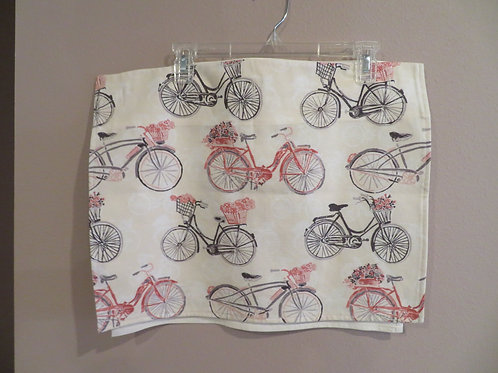 Bicycles with baskets of flowers