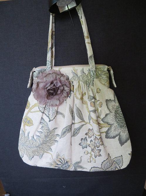 Purse with silk flower embellishment