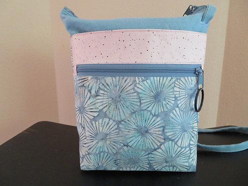 Pastel teal and coral tie dye pattern