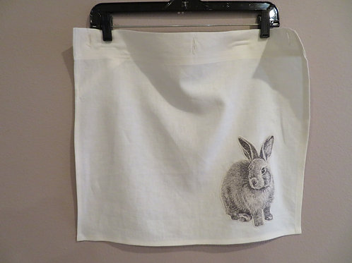 Gray bunny on off white background