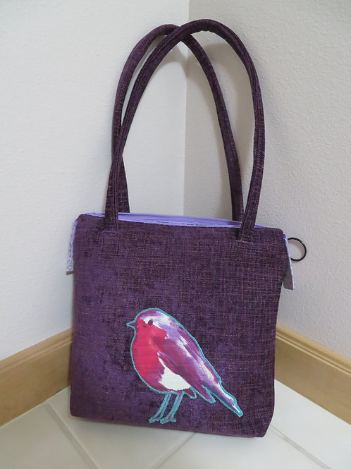 Red breasted Bird on Purple bag