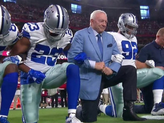 Dallas Cowboys take a Knee before Anthem and then stood tall locked in arms for the Anthem.