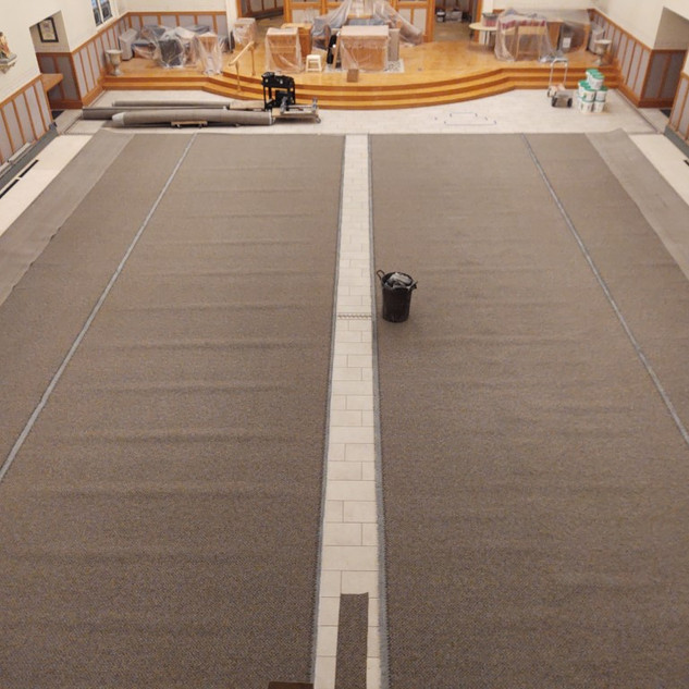 Carpet being laid out