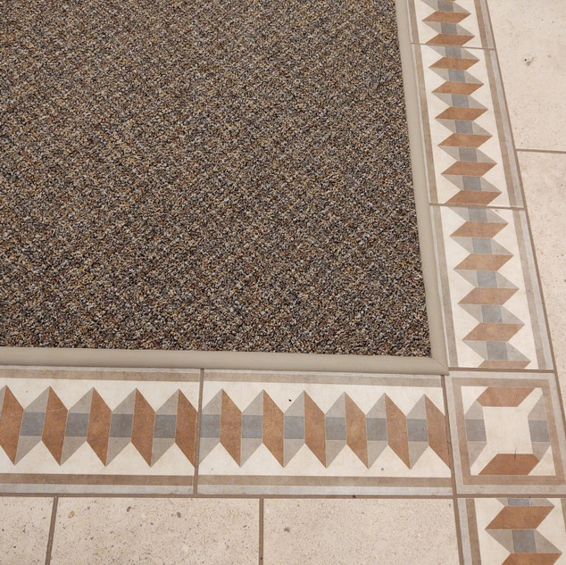 floor transitions installed between carpet & tile