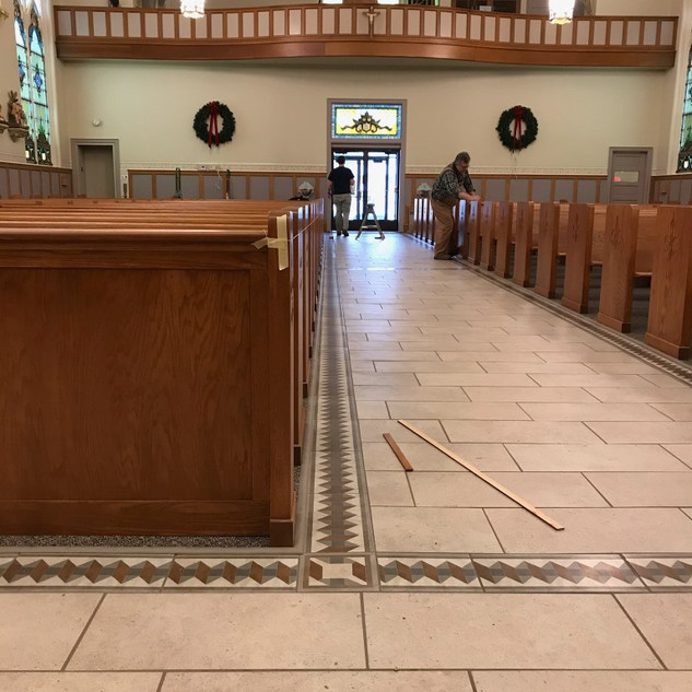 bolting down the pews