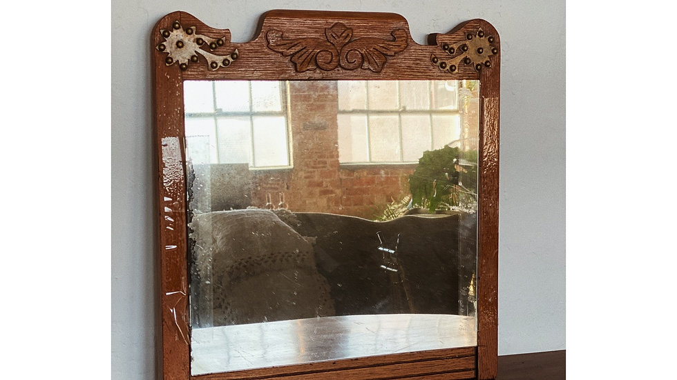 Wood mirror with brass details