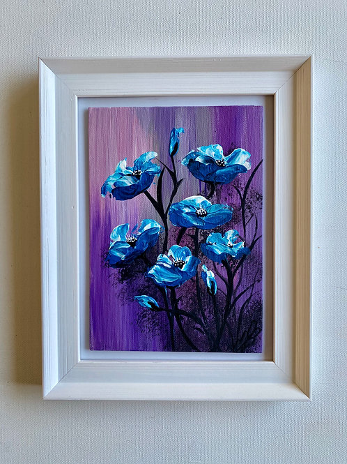 Sold/A Cluster of Blue Poppies in a Frame 19x24 cm