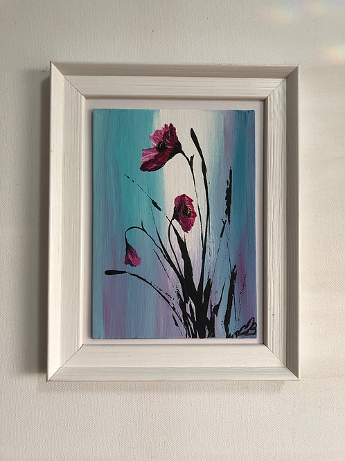 Purple poppies in a frame