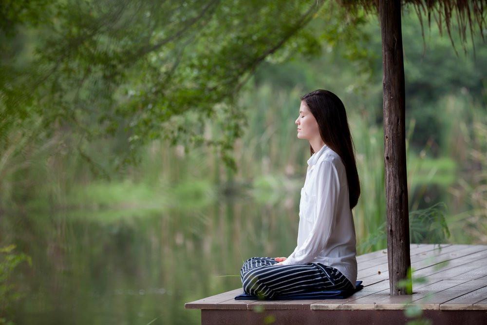 Image of woman meditating. Choosing mindfulness.