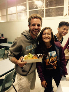 Happy students enjoying the delicious food we cooked.