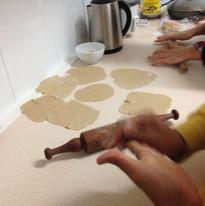 Making Puris (fried flat bread)