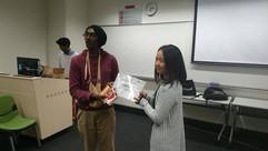Kamsari awarding a Happy Jiva graduation certificate.