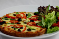 Vegetarian pizza with salad