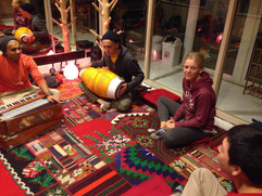 An intro kirtan at one of our city ashrams.