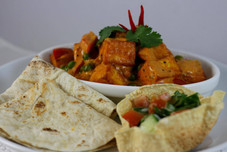 Cottage cheese curry with roti and papadams