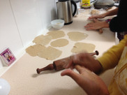 Our guests helping out with rolling round chapatis :P
