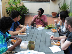 Kamsari answering spiritual questions from our guests over lunch.