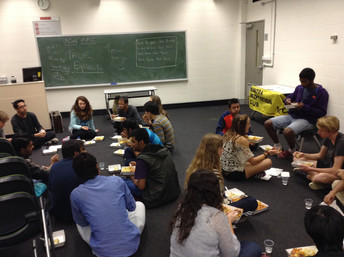Happy students eating prasad at one of our university programs