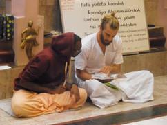 Kamsari teaching a monk trainee.