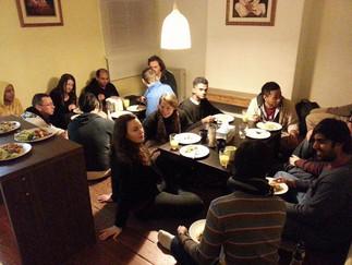Guests enjoying a prasadam feast after a Happy Jiva program