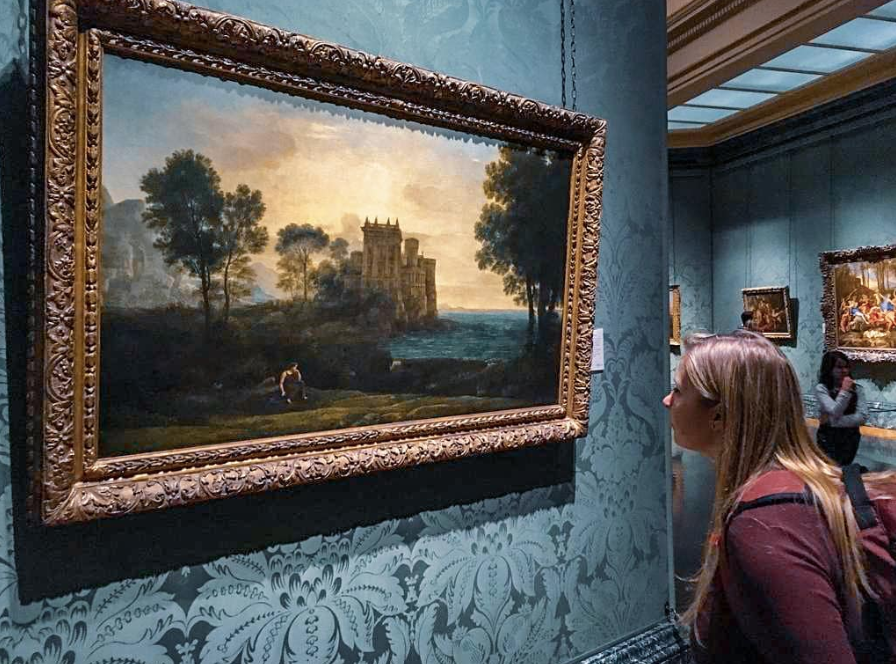 girl looking at a painting in the National Gallery in London