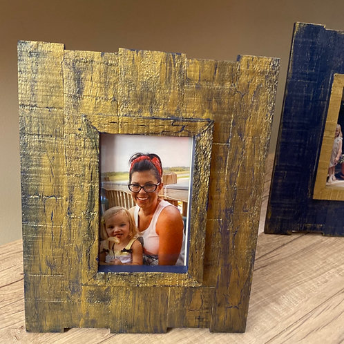 Gold frame with blue accents