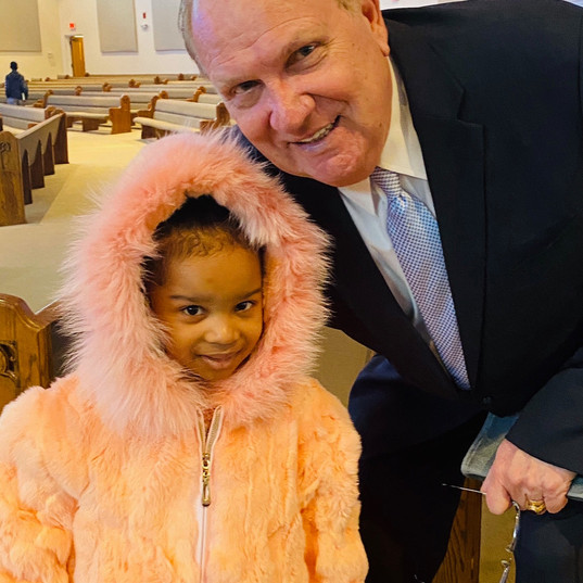 Pastor with young girl.jpg