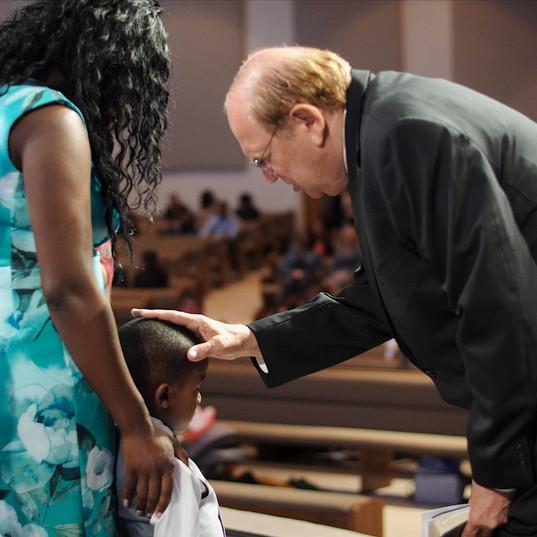 Pastor praying over little boy.jpg