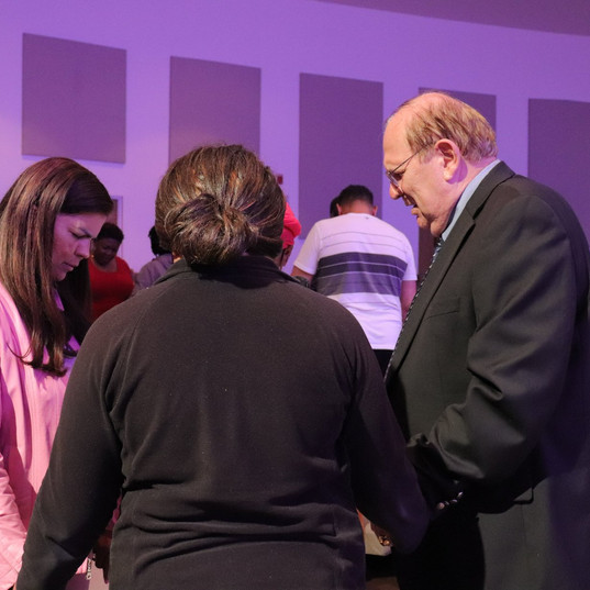 Pastor praying in Circle Group.jpg