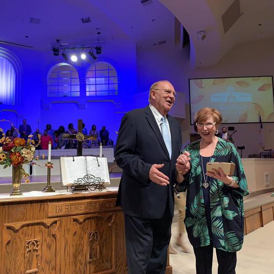 Pastor & Lynna smile at altar.jpg