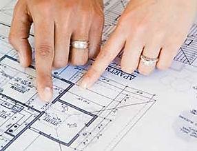 Surveyor and client discussing building plans