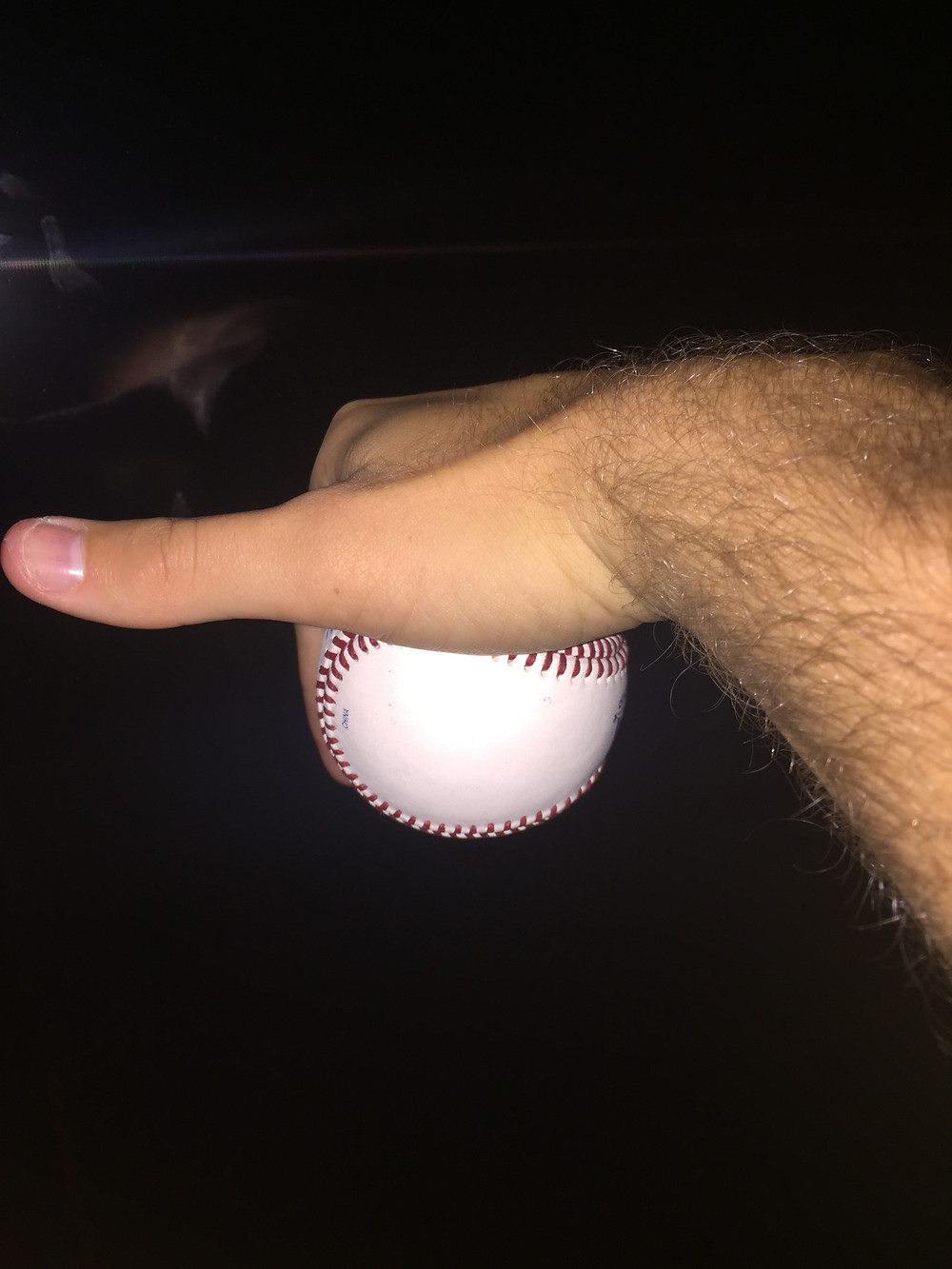 A 12-6 Curveball spins downward. The fingers are pointing doward. Spin axis is in direction the thumb.