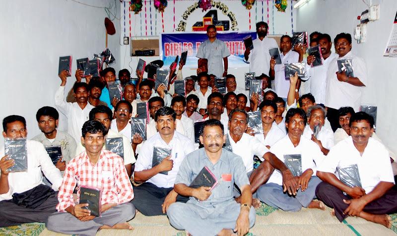 Pastor Raj conducting CFC Bible Distribution