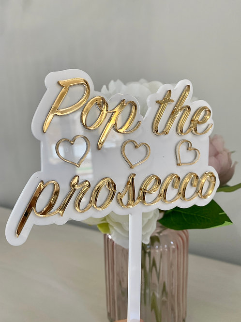 Pop the prosecco cake topper