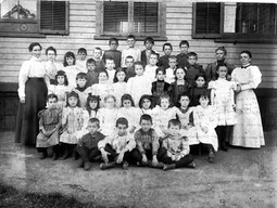 Mabel A Thayer on right with her class