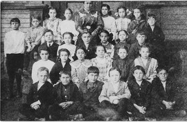 Evelyn Mowry with class yr 3 and 4
