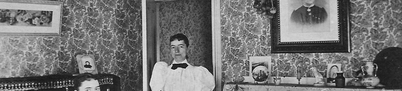Bessie on right and Hattie Sykes in their parlor