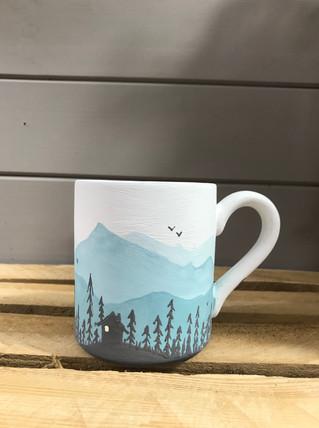 Paint a landscape on a mug