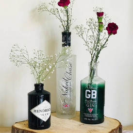 Variety of gin bottle centerpieces